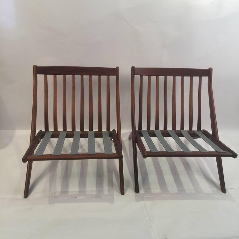 Pair of excellent teak scissor chairs made in Sweden by renown Danish designer Folke Olhsson and manufactured by DUX during the 1950s. Frames only, contact us for cushions and reupholstery.