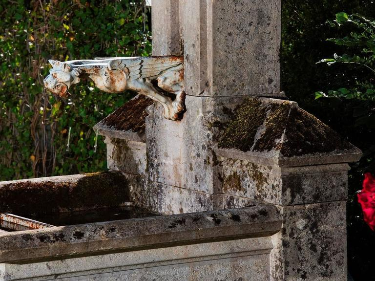 Shown here is a rare castle fountain originating from Loire, France. This unique fountain was made by Limestone in 1880 and still has an original feature - its spouter (only the emblem of the lion has had to be restored and is now in stainless
