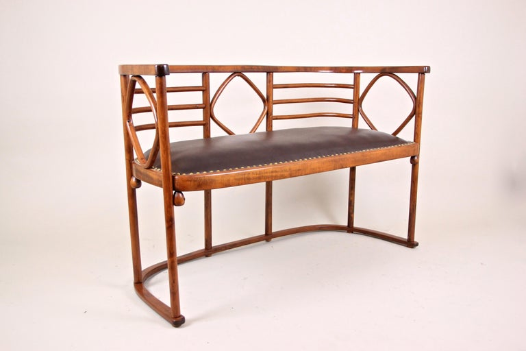 Unusual seating set attributed to Josef Hoffmann for Thonet, Austria, circa 1910. Made of beechwood that was bent under steam and high pressure the bench and the two armchairs were upholstered in fine brown leather. Overall an absolute amazing