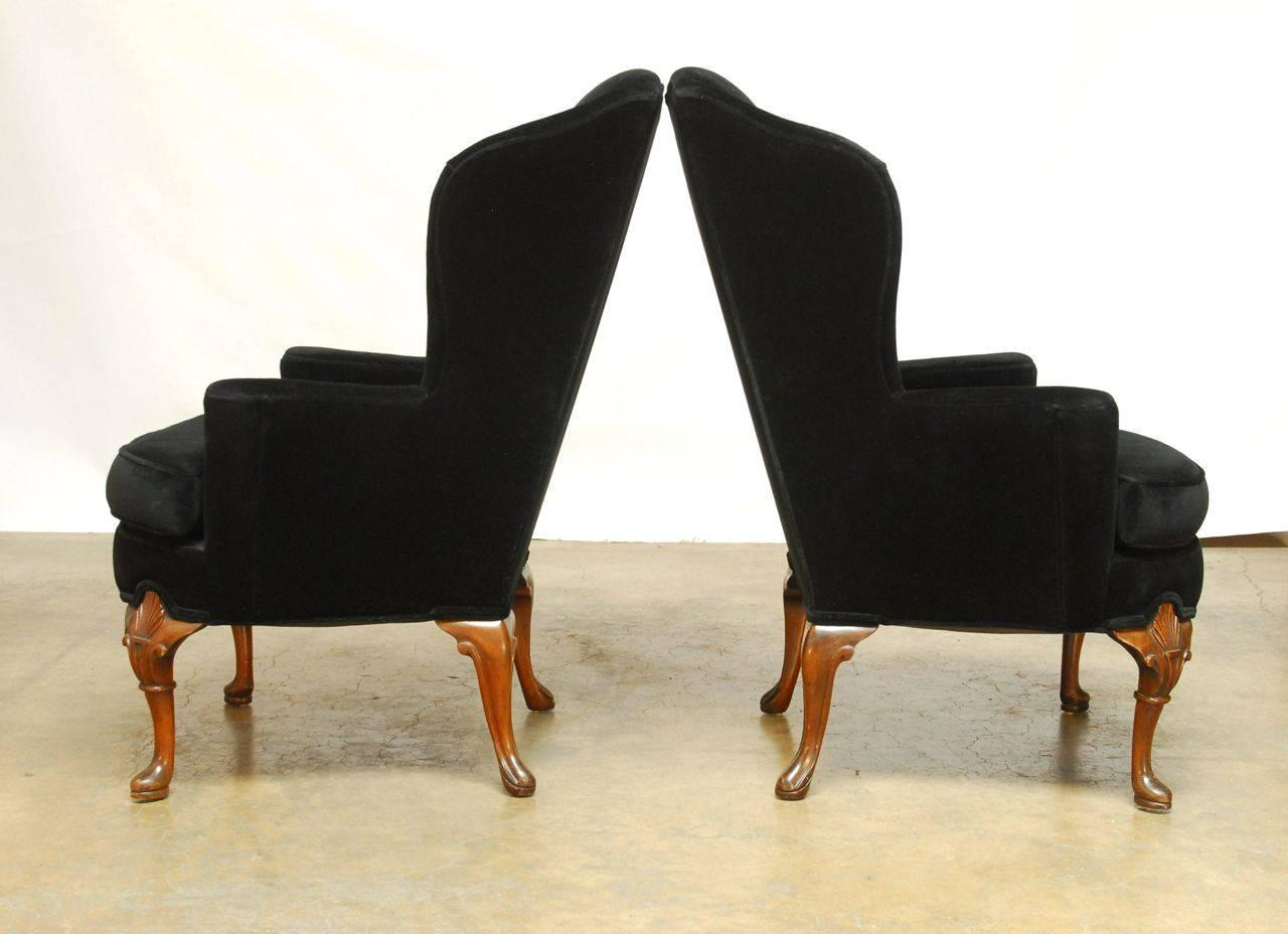 Pair of George III Style Black Velvet Wing Chairs For Sale