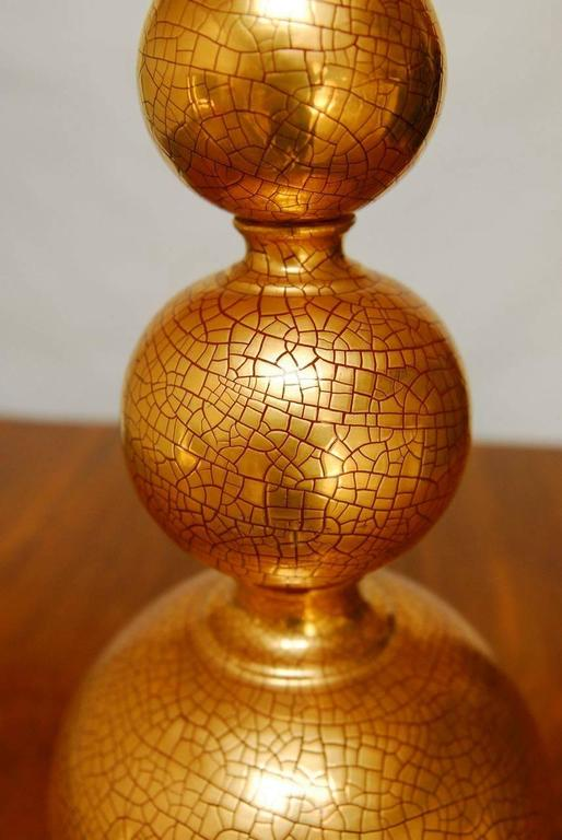 Chic stacked ball table lamp with copper patinated crackle finish. The orbs are exceptional metal castings with finely detailed recessed relief texture. Base and finial are gilt in copper tones matching the lamp. Made by Marbro Lamp Co.