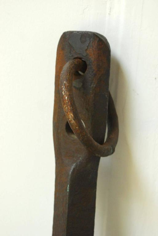 Extraordinary ships anchor with a heavily patinated finish on the cast iron. Very solid heavy anchor that is sea worn and still has the shackle or ring. Handsome display piece with traditional diamond shaped blades on the crown. Large enough for an