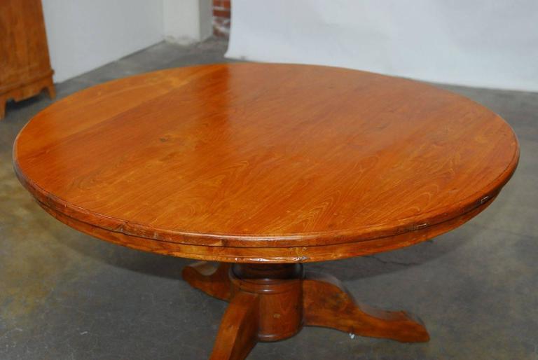 Hand-Carved Solid Teak Round Pedestal Dining Table at 1stdibs