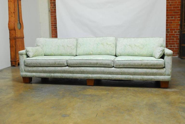 Spectacular Mid-Century sofa featuring a vintage Fortuny style upholstery in a cool mint green color. Long modern low-back style sofa supported by six square wooden feet. Excellent condition with generous seating for four. The fabric features a