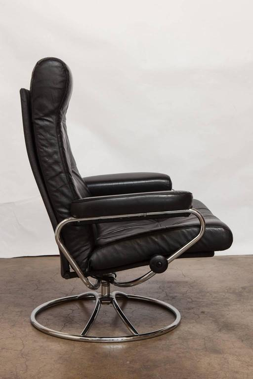 midcentury ekornes stressless reclining lounge chair and ottoman at
