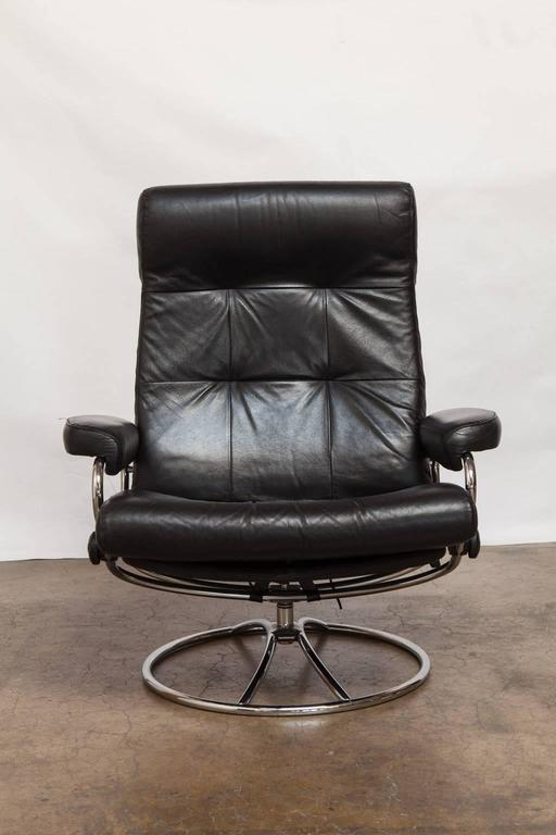 Mid Cenury Modern Ekornes Stressless Black Leather Reclining Lounge Chair  And Ottoman Featuring A Chrome