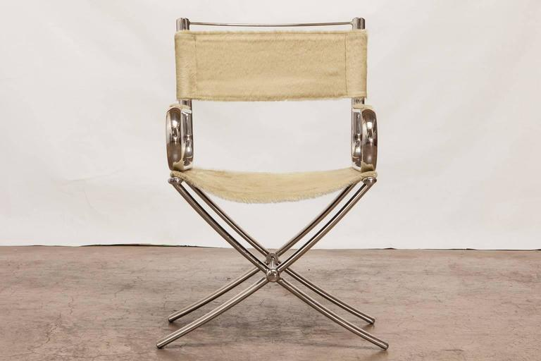 Chic chrome directoru0027s chair by Eric Brand featuring a light colored cowhide saddle and back. & Chrome and Cowhide Johnsonian Directoru0027s Chair by Eric Brand For ...