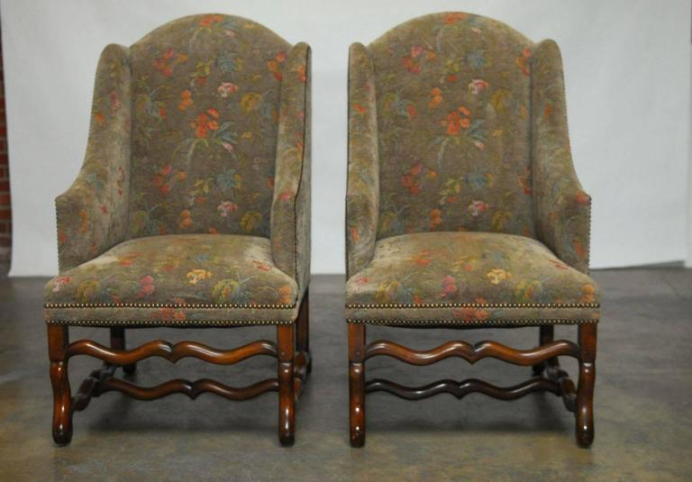 pair of walnut os de mouton upholstered wingback chairs 2