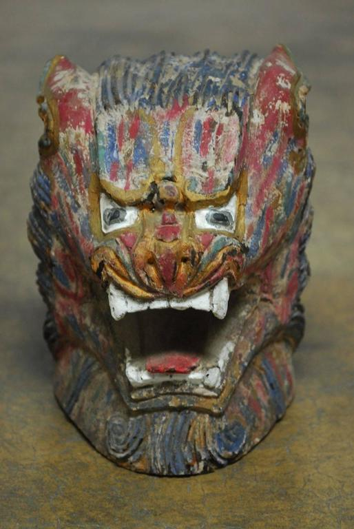 Qing Pair of Polychrome Foo Lion Roof Ornament Heads For Sale