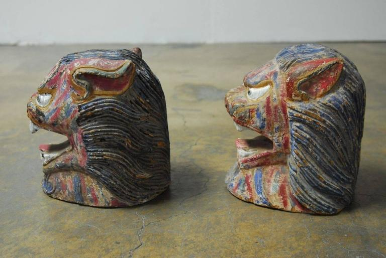 Hand-Carved Pair of Polychrome Foo Lion Roof Ornament Heads For Sale