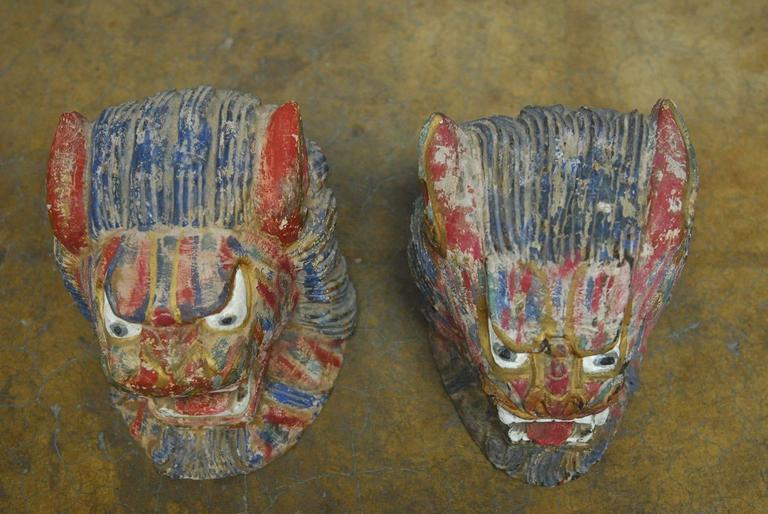 Southeast Asian Pair of Polychrome Foo Lion Roof Ornament Heads For Sale