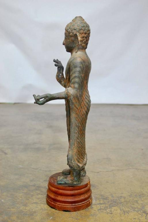 Cast Iron Standing Buddha on Stand For Sale 3