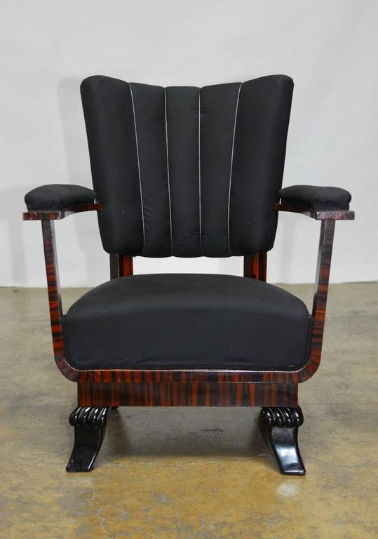 Fantastic pair of French Art Deco period armchairs featuring a unique architectural open design with