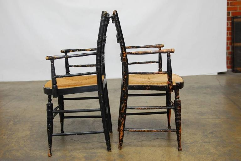 Pair of 19th Century Faux-Bamboo Hitchcock Style Armchairs In Distressed Condition For Sale In Oakland, CA
