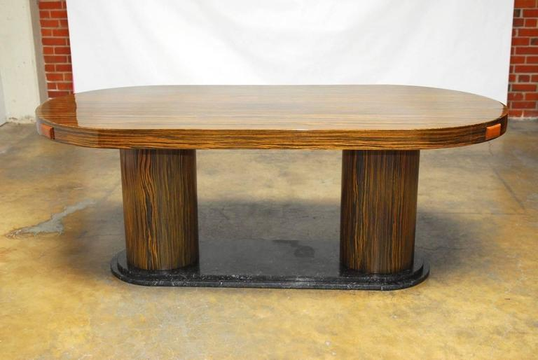 Exquisite Italian zebrawood conference table made in the modern style with two large round pedestals mounted to a stepped marble base. Finished in a high gloss to accent the rich African wood grain with a thick 3
