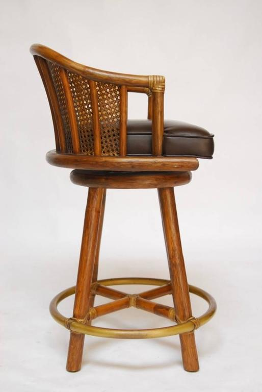 Set Of Four Mcguire Bamboo And Cane Swivel Barstools At