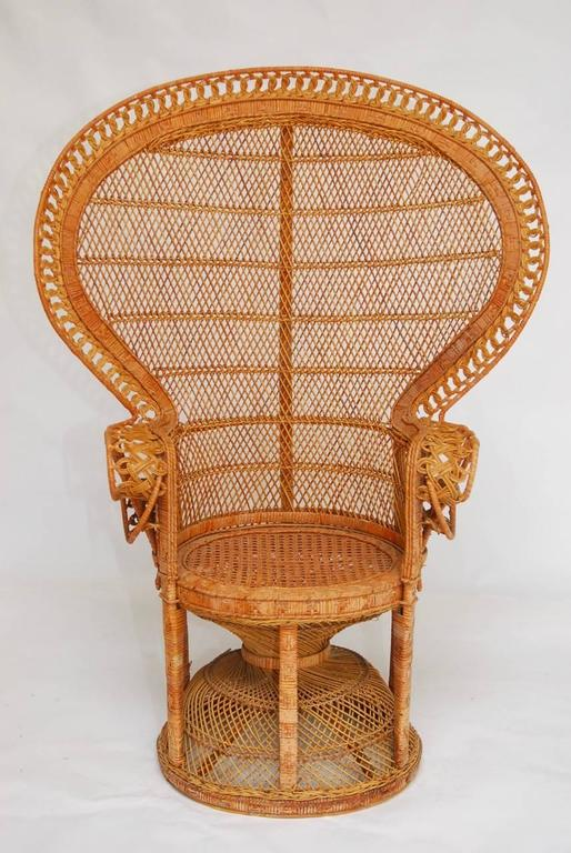 Iconic Matched Pair Of Rattan And Wicker Emmanuel Peacock Chairs. Featuring  A Full Fan Back