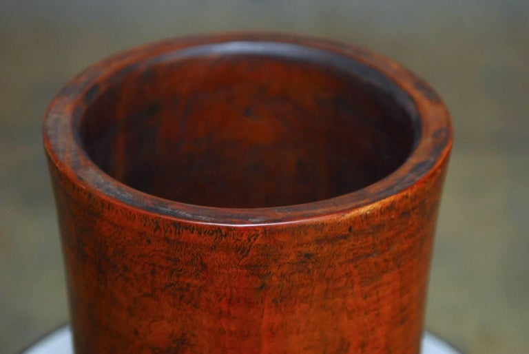 Rare and unusual 19th century monumental Chinese rosewood brush pot carved from a large, solid trunk. Beautiful crafted with a subtle hourglass cylindrical shape. Featuring rich and complex grain patterns. Weighs nearly 15 pounds.