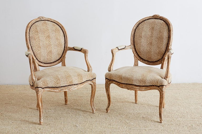 Hand-Carved Pair of French Louis XV Style Upholstered Fauteuils For Sale