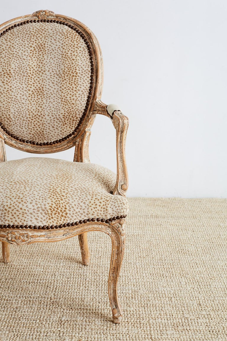 Pair of French Louis XV Style Upholstered Fauteuils In Excellent Condition For Sale In Oakland, CA