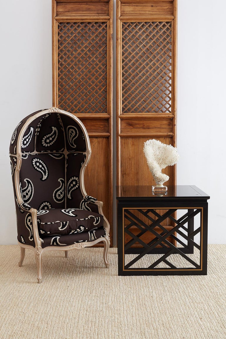 Pair of stunning black lacquered trellis tables by Carleton Varney for Kindel furniture. These fabulous tables feature Chinese Chippendale style geometric fretwork. Lattice panels on the sides with a gilt accent on the border. The open sides have an
