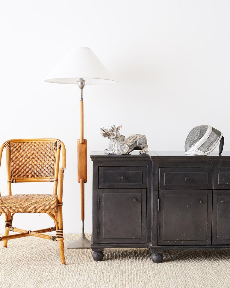 Industrial style zinc metal wrapped sideboard, credenza or buffet. Features a hand-wrapped sheet metal zinc cover secured with thousands of hand-hammered tiny nails. The zinc has a rich dark grey oxidized finish that give it a very unique patina and
