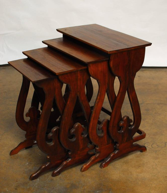 Set of four carved chinese nesting tables for sale at stdibs