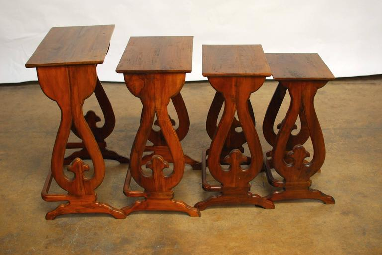 Set of four carved chinese nesting tables for sale at 1stdibs set of four hand carved asian nesting tables featuring an hourglass form design each watchthetrailerfo