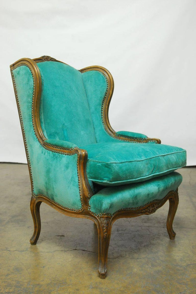 Hand-Carved Pair of Louis XV Style Turquoise Velvet Wingback Bergères For Sale