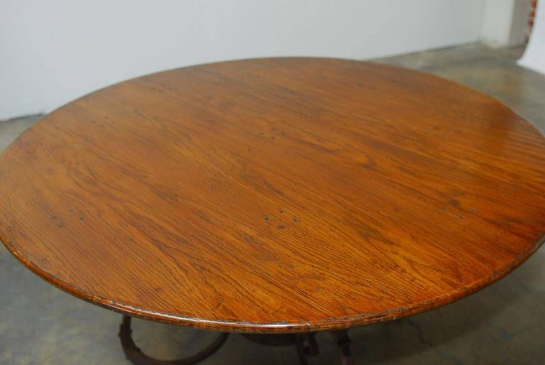 italian oak and scrolled iron round dining table for sale at 1stdibs