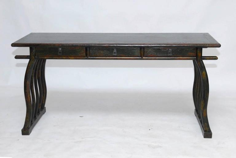Rare and unusual Chinese writing table or scroll viewing table from Shanghai made in the Chinese Deco style. Fronted by three drawers, supported by five serpentine legs on each side and conjoined with a stretcher. This desk features a beautifully