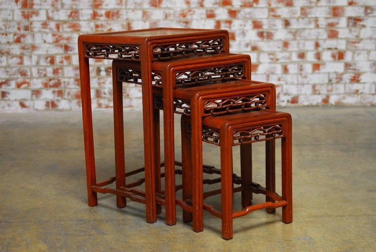 Set of four chinese carved hardwood nesting tables for