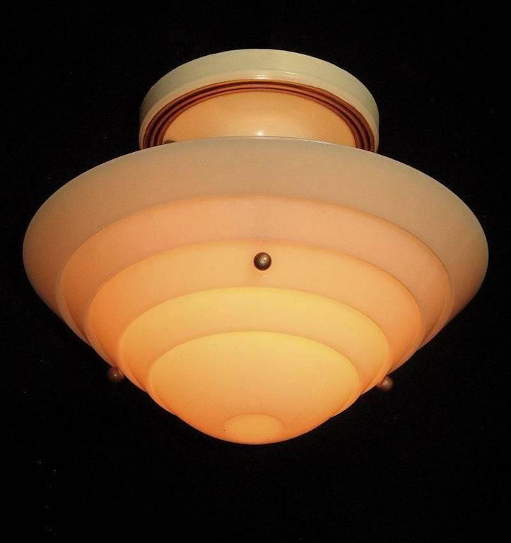 From the 1930s when designers were heading full tilt into the Mid-Century style. All original parts, except updated wiring and it has been restored to its original color scheme of cream fixture with antique golden highlights which really set off the