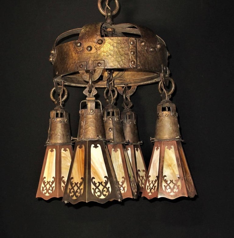 Wonderful and heavy Arts & Crafts era five-light ceiling fixture with it's original finish and patina intact. Made of bronze or brass plated cast iron and bronze. Perfect for an entry light or over the dining room table. The centrepiece for