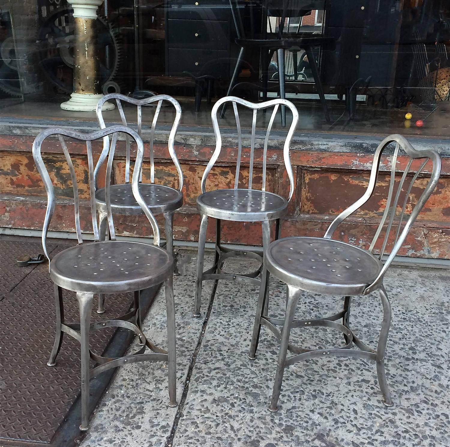 Pair of industrial brushed steel toledo café chairs for