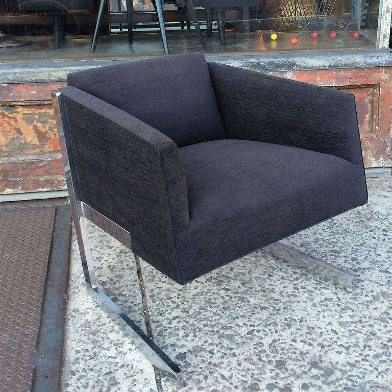 Mid-Century Modern, lounge chair in the style of Milo Baughman with low profile, cantilevered chrome frame, upholstered in a rich black chenille.