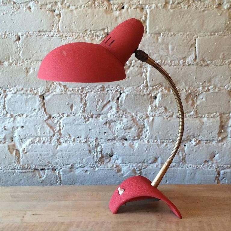 Mid century modern, brass gooseneck, desk lamp with red shrink paint base and shade circa 1950's