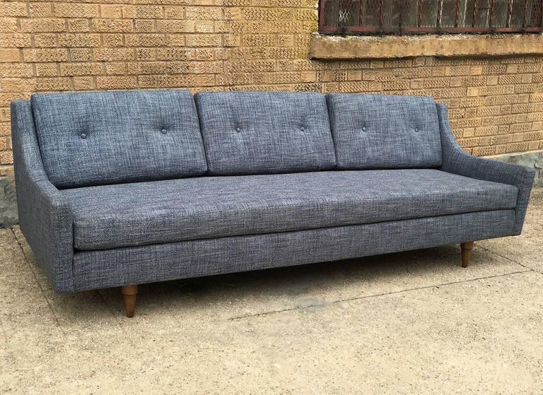 Danish modern sofa by Selig with sloped arms and conical teak legs is newly upholstered in a blue and white tweed blend.