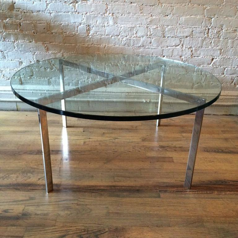 Mid-Century Modern, chrome, x-base, coffee table with a thick green glass top.