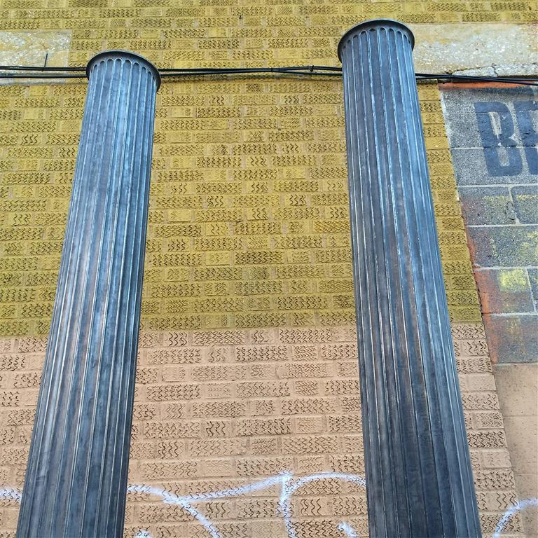 Industrial Pair of Architectural Gunmetal Steel Fluted Columns For Sale