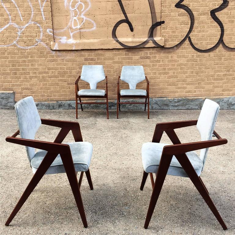 Set of four, rare teak compass chairs by Dutch born sculptor and draftsman Cornelis Zitman for Tecoteca, Furniture designed for the Hotel Humboldt, Caracas Venezuela 1955. These stunning, limited edition, dining armchairs sport dramatic,