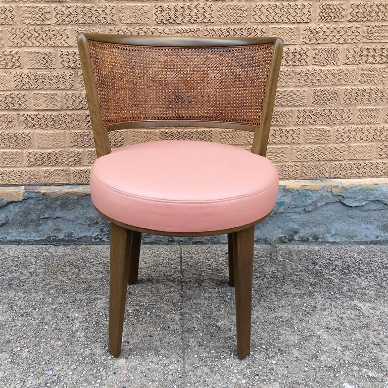 Mid-Century Modern, pickled mahogany vanity chair by Edward Warmly for Dunbar with caned back and blush pink leather upholstered seat.
