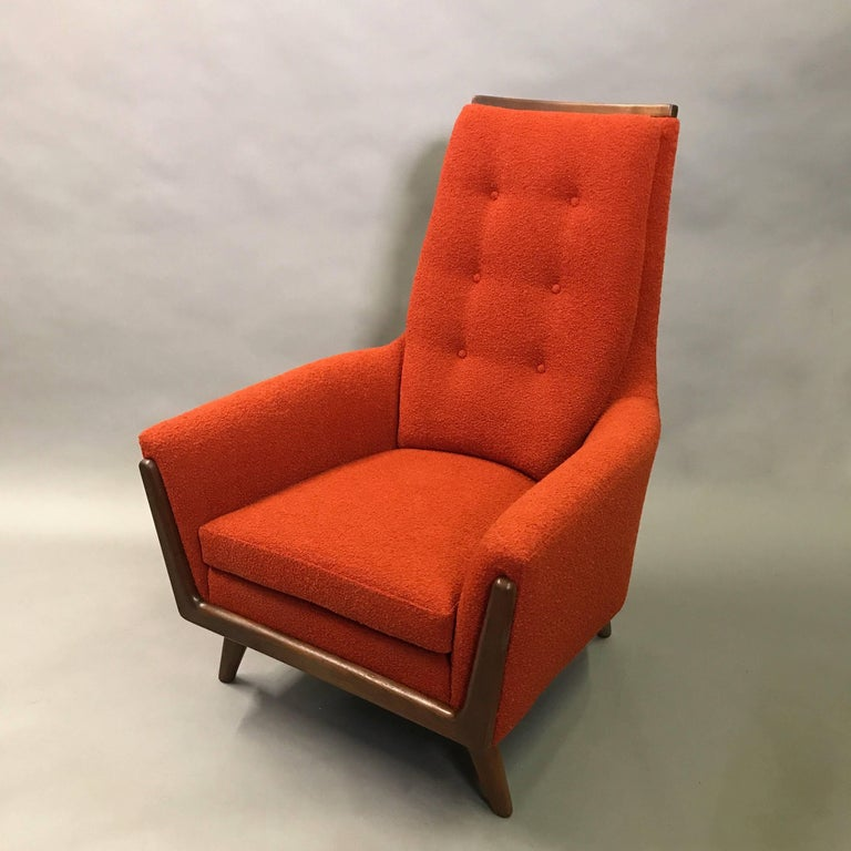 Mid-Century Modern, upholstered, high back armchair or lounge chair designed by Adrian Pearsall is newly restored with a vibrant, burnt-orange, wool blend upholstery and walnut base and arm details.