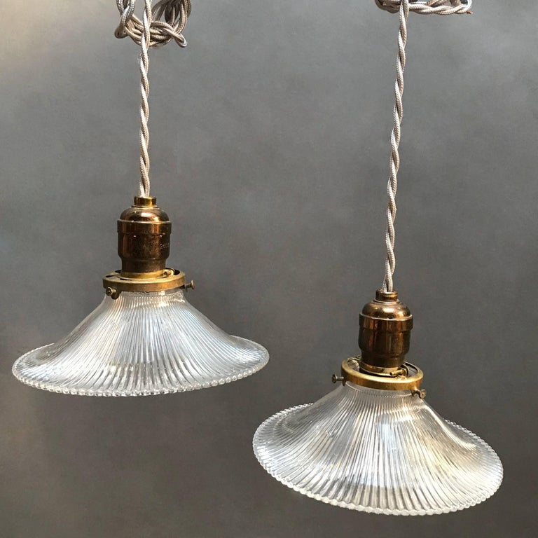 Pair Of Sloped Prismatic Holophane Glass Pendant Lights At