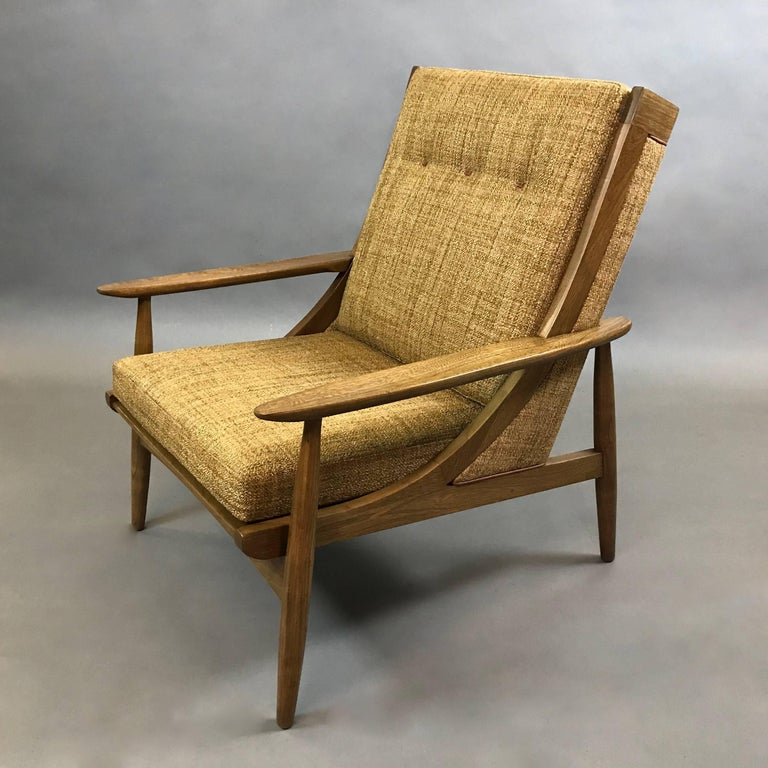 Italian, mid century modern, high, slat back, lounge chair features an ash frame with attached butterscotch tweed blend upholstery accented by tan leather trim and custom leather button details - a stunning chair from all angles.