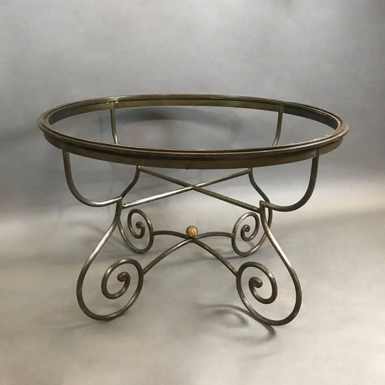 Craftsman made, Hollywood Regency, steel dining table frame features a beautifully scrolled base with brass ball detail. The table can accept your 42 in top of your choice - glass, marble, etc. that sits within the frame of the table.