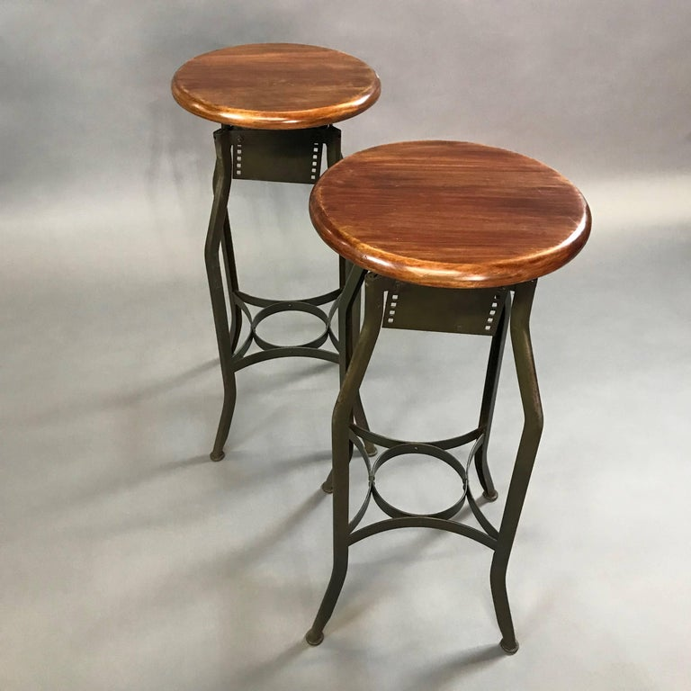 Painted Pair of Industrial Height Adjustable Toledo Shop Stools For Sale
