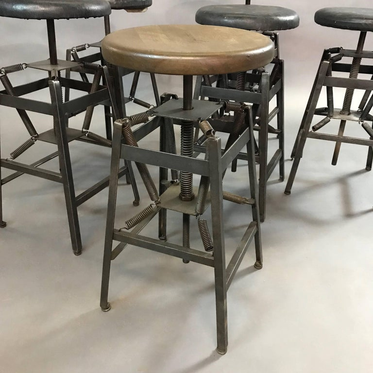 Industrial Adjustable Drafting Spring Stools by American Cabinet Co. In Good Condition For Sale In Brooklyn, NY