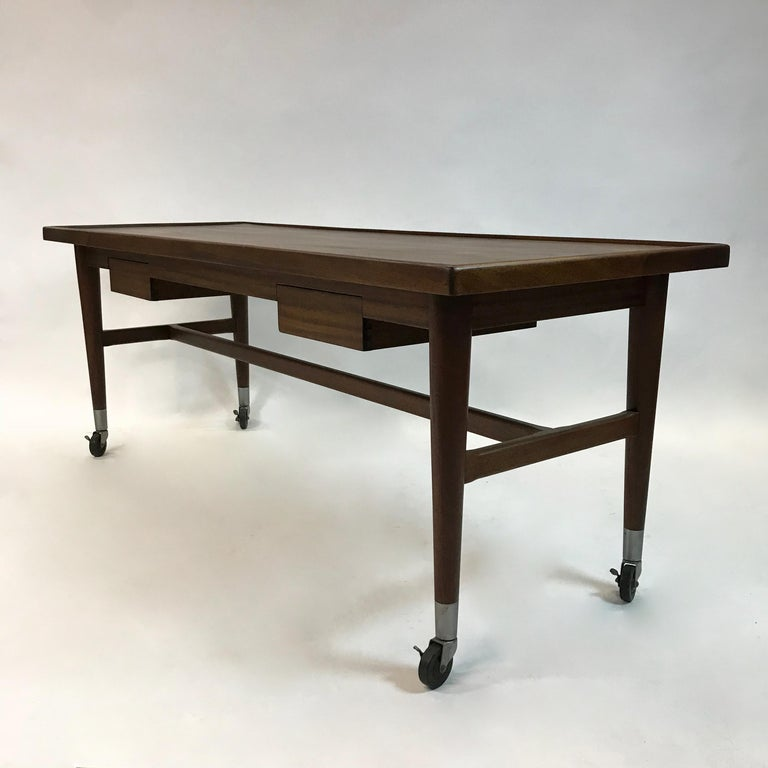 Custom-made, rolling, mahogany, architect, lay-out, work table or desk features two drawers and long work surface with a 1/4 inch lip that can be used as is or with a leather or vinyl insert.
