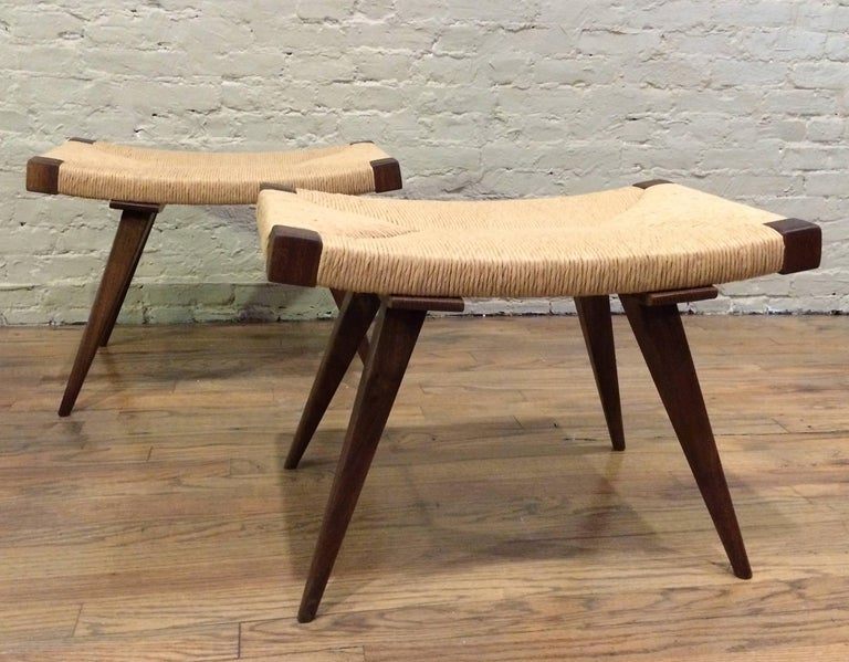 Mid-Century Modern style, ottomans / stools / benches feature walnut and ash tapered legs with woven rush seats are custom-made in Brooklyn, NY by City Foundry. Available in 24 inch, 36 inch and 48 inch widths. Quantities available with a 90 day